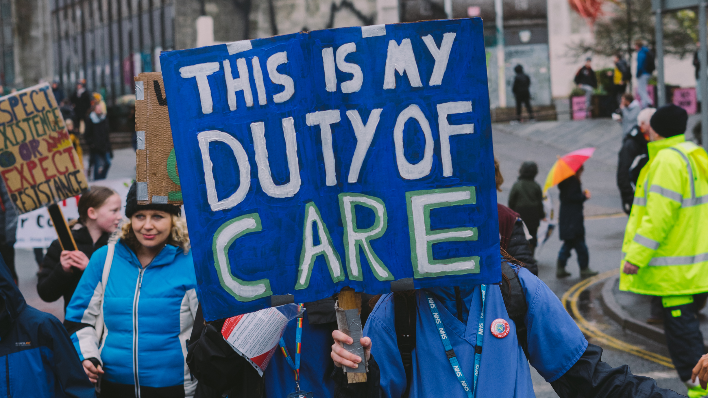 Blue activist poster with white text which reads 'This is my duty of care'